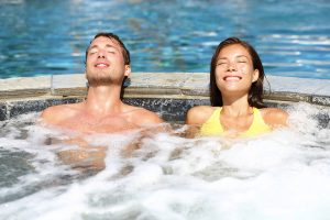 Man and woman relaxing in heated pool